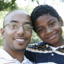 A father and son created through foster care adoption embrace.