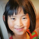 Young girl from China smiles at the camera.