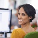 A woman attends a webinar.