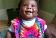 Catherine's son when he was around 1, wearing a tie-dye shirt.