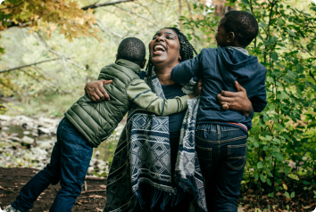 A foster mom hugs her two foster sons who have just come into her care.